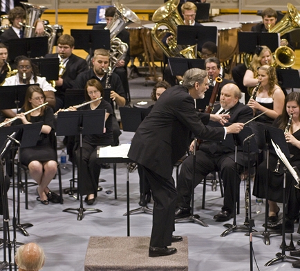Man conducting a playing orchestra