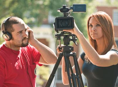 Man and woman looking at a camera