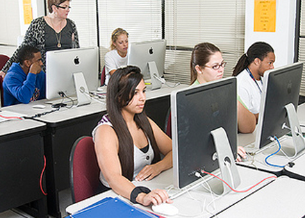 Students in class using computers