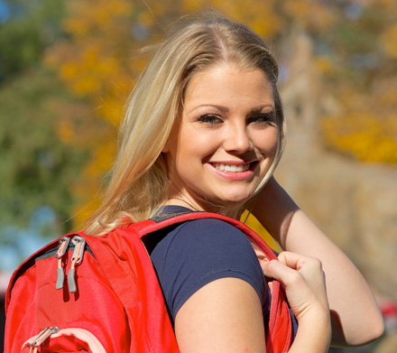 Girl wearing backpack smiling