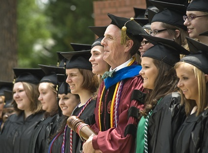 People standing in graduation gown and caps