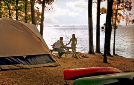 Two people camping lakeside