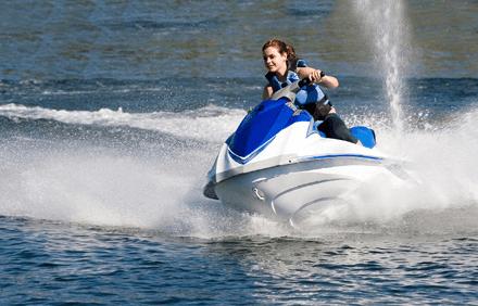 Women riding a jet ski