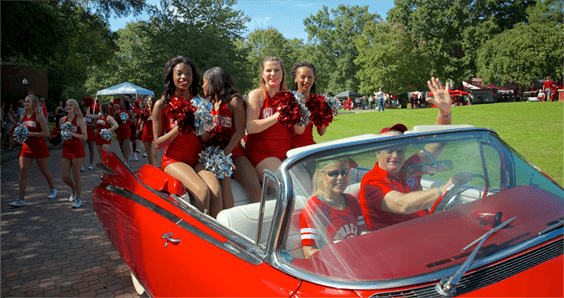 Cheerleader in parade car