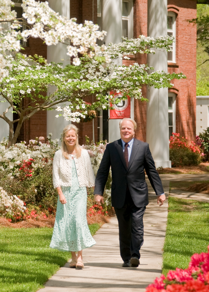 Dr. Scherrens and his wife walking on campus