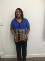 Dr. Barnes-Winder holding award