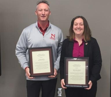 Knight and Haskett holding award plaques